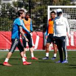 Zidane takes charge of his first session